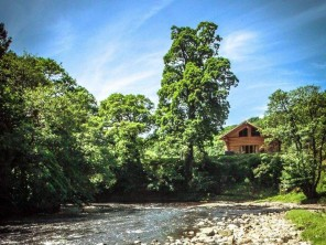 Roe Deer Riverside Log Cabin with Private Hot Tub in Rural Cumbria, near Carlisle, England