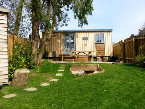 Romantic Shepherd's Hut Keep with Woodland Sauna & Lakeside Hot Tub near Crewkerne, Somerset, England