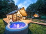 Tent with hot tub