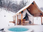 Tent and hot tub in snow