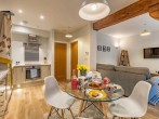 Original beams add to the charm in the living space