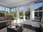 Sun room with french doors to patio and garden