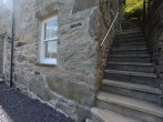 Steps down to the property