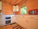 Kitchen accessed via living area