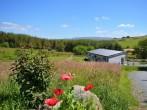 Cedar lodge situated in an idyllic rural location