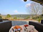 Admire the views from your undercover decking over breakfast