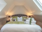 King-size bedroom with a splash of colour