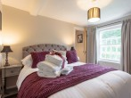 King-size bedroom with rich colours for an opulent feel