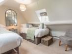 Twin bedroom with calming muted tones