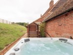 Tucked away, the hot tub offers ultimate seclusion