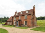 A grand detached farmhouse, perfect for family gatherings