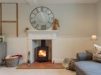 On cooler evenings, light the woodburner and enjoy the warmth