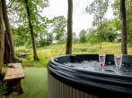 Enjoy the bubbles in the hot tub whilst listening to bird song