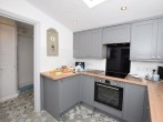 Take a refreshing shower in this white bright shower room