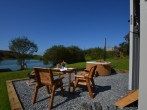 Sun-trap gravelled patio area overlooking the lake