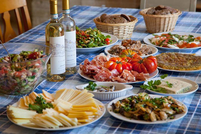 Al fresco dining in luxury lakeside villa in Italy
